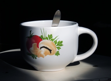 Cup with a picture on a background of darkness Stock Photo