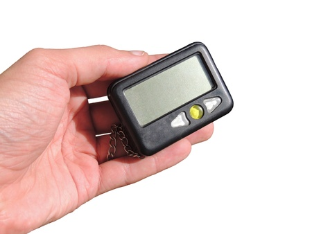 pager in hand isolation on white background