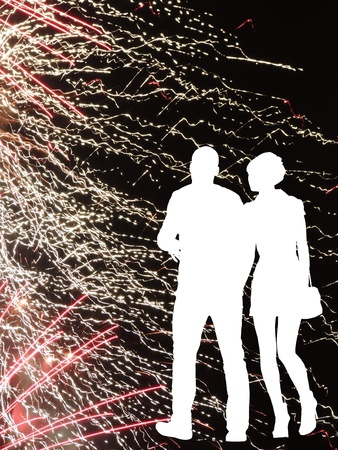 the silhouette of a guy and a girl on the background of fireworks abstract background photo
