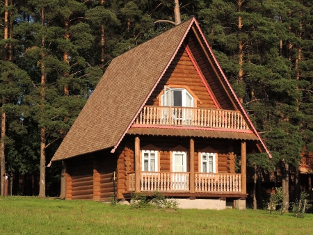 wooden house on the nature in the pine forest