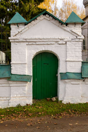 old gate in the stone fence, entrance to the temple grounds