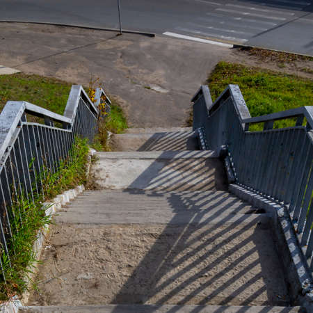 street stairs with railings for getting off the bridge
