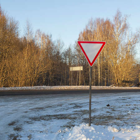 road signs give way on the side of the road Stockfoto