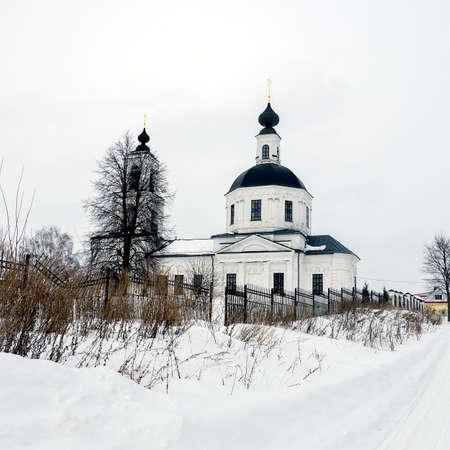 White brick Orthodox church in winter, Sungurovo village, Kostroma region, Russia