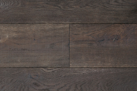 lumber room: Texture dark brown parquet as abstract texture background, top view. Material wood, oak, maple. Stock Photo