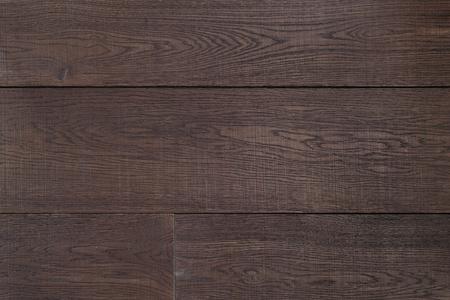 Textuur donkerbruin parket als abstracte textuur achtergrond, bovenaanzicht. Materiaal hout, eik, esdoorn.