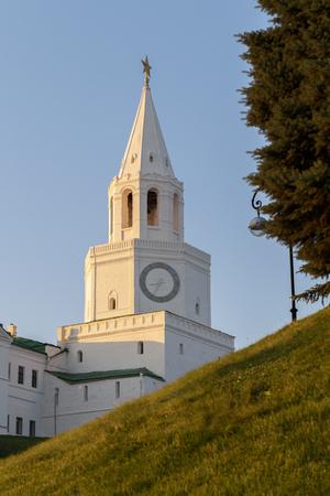 spasskaya: Spasskaya tower of white stone in the Kazan Kremlin in the rays of the setting sun. Stock Photo