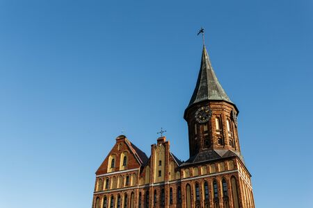 Part of the facade in the Konigsberg Cathedral and the old clock tower. Stock Photo