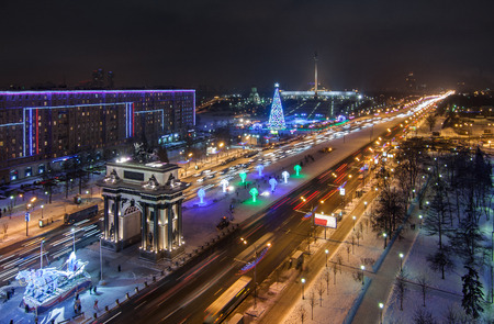 stele: top view moscow River and Moscow Kremlin in winter night triumphal Arch and Victory Park in Moscow in winter night.