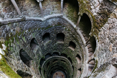 stair well: Initiation Wells. Deep well in the territory of Quinta da Regaleira. Old spiral staircase goes down.