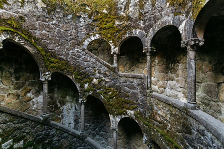 Initiation Wells in Sintra. Old spiral staircase with columns on the territory of the Quinta da Regaleira