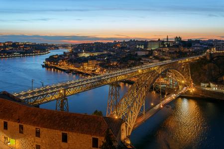 dom: Dom Luis I Bridge in Porto on sunset background.