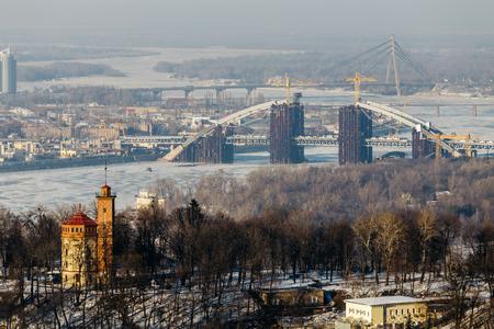 Top View of the Dnipro park and Podolsky bridge in Kiev, Ukraine  in winter day.
