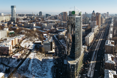 Top view on modern business center Parus, boulevard Lesia Ukrainka and street Mechnikov winter day. Former highest building in Kiev, Ukraine.