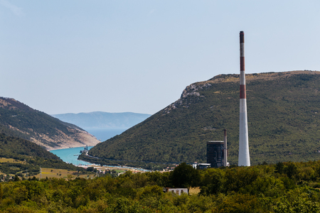 tall chimney: Tall chimney of coal power plant near the town of Plomin, Croatia. Stock Photo