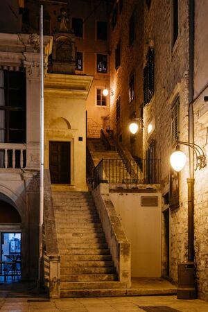 passageway: empty night street with stairs in the historic center of Sibenik, Croatia.