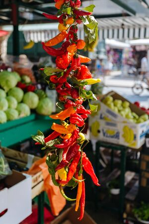 Red and green pepper hanging on the market in Omis, Croatia.