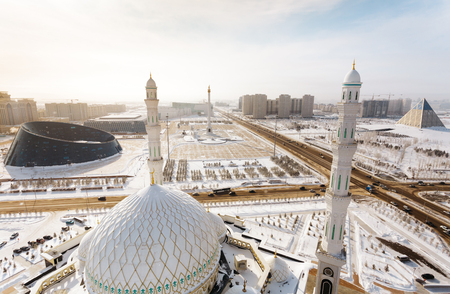 The view from the minaret of the mosque Hazrat Sultan at the Independence Square with the Palace of Shabyt and Kazak Eli Monument in Astana, Kazakhstan Stock Photo