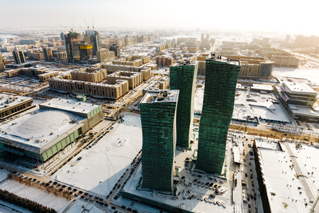 Top view of the Northern Lights residential complex and the city in the warm sun in Astana, Kazakhstan