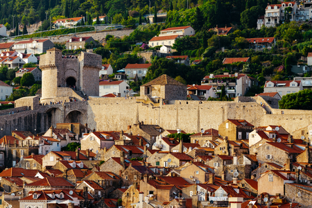 Protective city wall, Minceta tower and houses with red tiles in Dubrovnik, Croatia