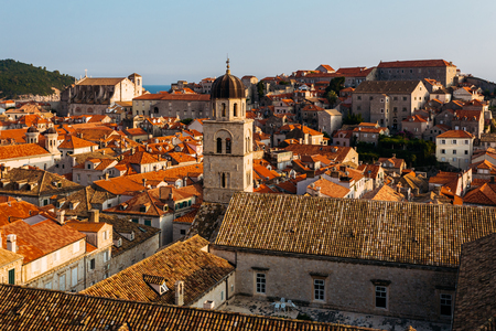 Franciscan Monastery and Museum on the background of houses with in Dubrovnik, Croatia.
