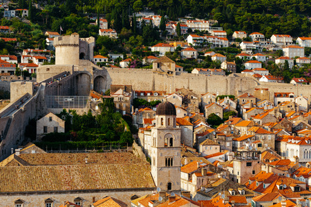 Protective city wall, Minceta tower and Franciscan Monastery and Museum in Dubrovnik, Croatia.