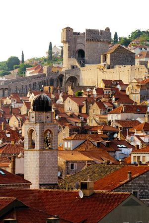 Bell tower, Minceta tower and houses with red tiles in Dubrovnik, Croatia.