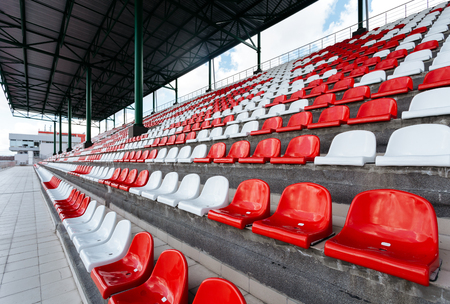 Empty seats of red and white in the stands of the race track Reklamní fotografie