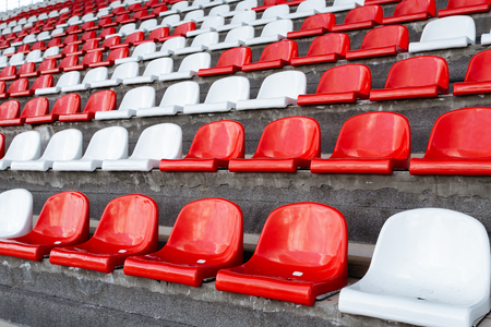 Empty seats of red and white in the stands of the race track Stock Photo