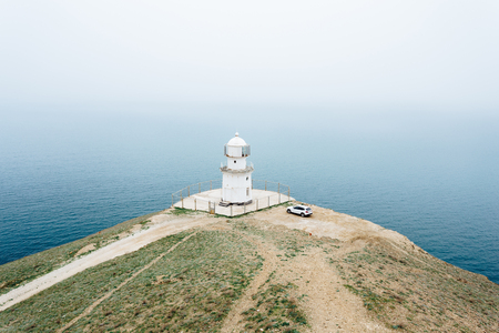 White lighthouse on Cape Meganom in Crimea in Russia.