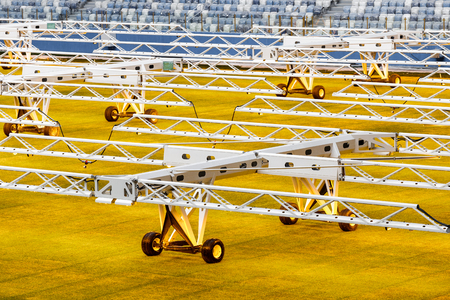 Artificial light system for growing lawns on football stadiums. Reklamní fotografie - 106224130