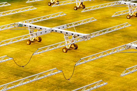 Many lamps with artificial light for growing lawns on football stadiums Stock Photo