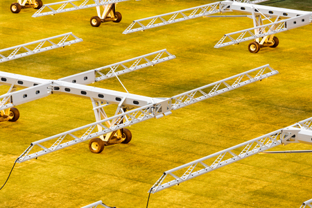 Artificial light system for growing lawns on football stadiums. Reklamní fotografie - 106224137