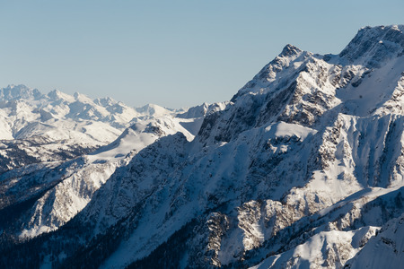 Steep slopes of the snowy mountain massif in Sochi, Russia. Reklamní fotografie - 106222314