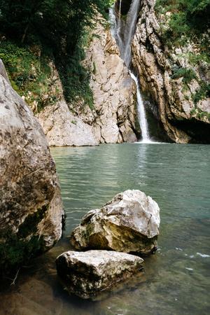 The average Agur waterfall in the Agur Gorge in Sochi. Reklamní fotografie - 106222319