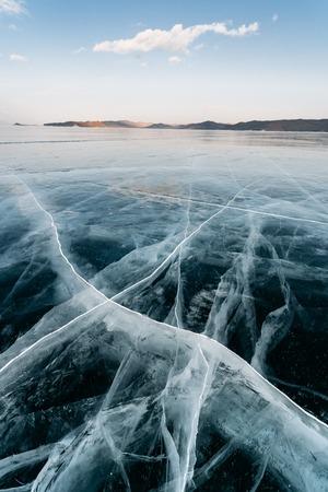 Huge cracks in the ice of Lake Baikal, Russia. Reklamní fotografie - 126270512