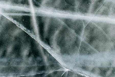 Texture and pattern of cracks in frozen ice. Reklamní fotografie - 126270535