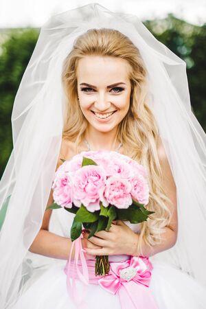 arm bouquet: Bride holding wedding bouquet on wedding ceremony Stock Photo