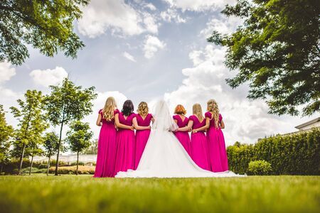 bridesmaids: Bride with bridesmaids in a park on the wedding day