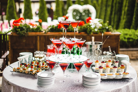 banket: Pyramid of glasses with wine on the table Stock Photo