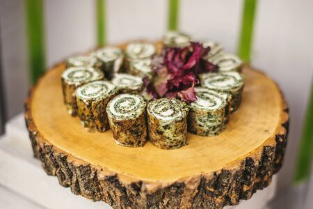 pinwheels: Roll with spinach, sliced on wooden stump