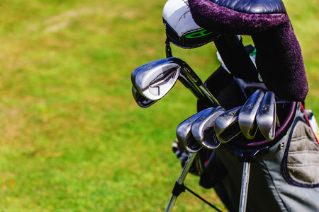 golf equipment on green and hole as background