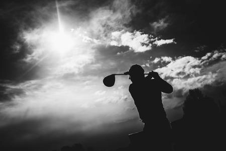 golfplayer hits a ball silhouette 版權商用圖片