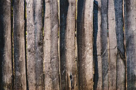 Close up of line light brown wooden fence