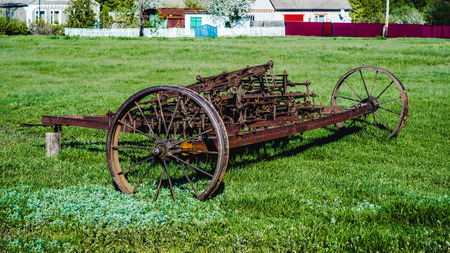 Old iron plow used in the past as a tool in agriculture