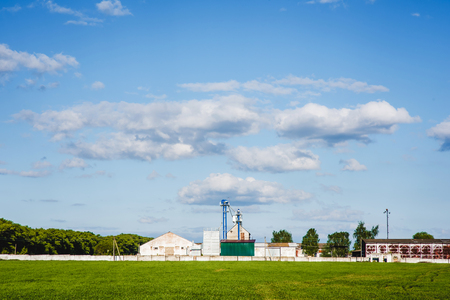 farm grain silos for agriculture with blue sky on the background