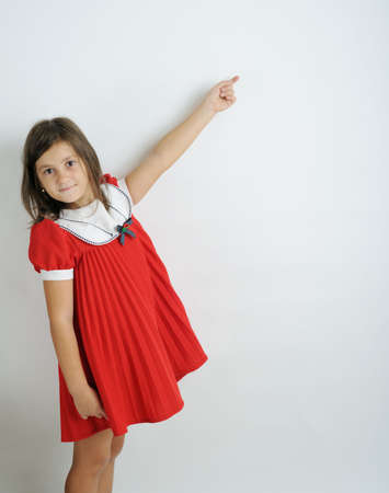 textfield: A little girl pointing out on blank space Stock Photo