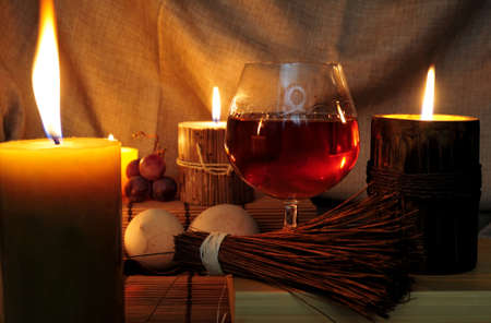 snifter: Close up of congnac in brandy snifter lighted by candles Stock Photo
