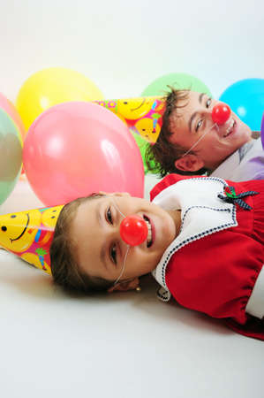 A little girl and a boy with party horn and clown noses Stock Photo - 3716886