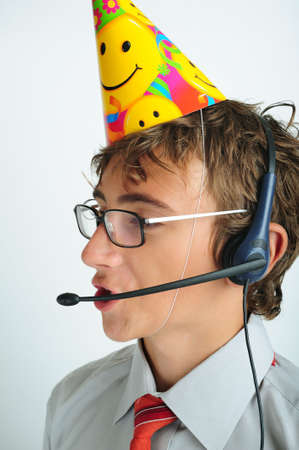 handsfree phone: Young boy with party horn and hands-free phone device Stock Photo